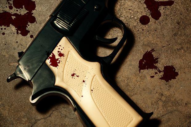 Pistol revolver gun with blood stain