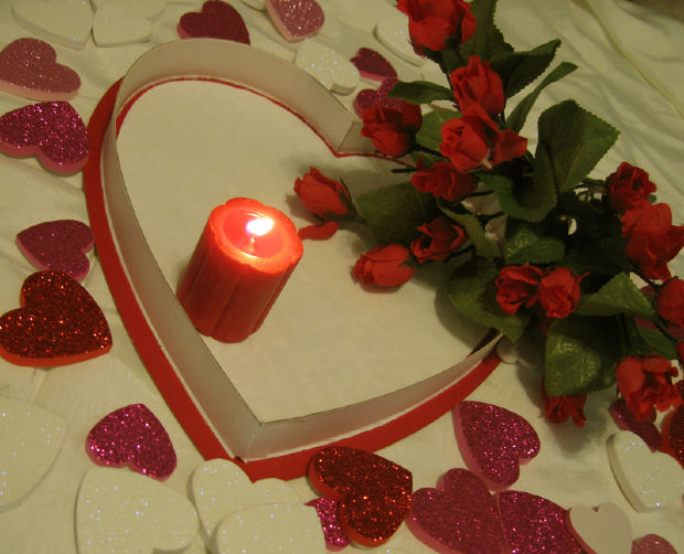 candle light with rose and heart shape cuts