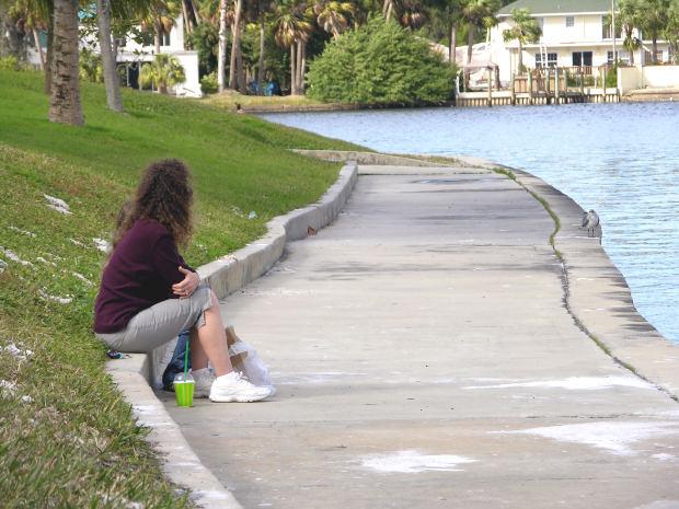 girl-alone-near-lake