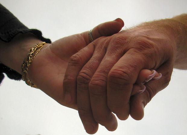 man-woman-holding-hands