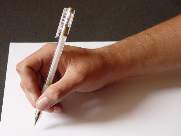 paper-hand-pen-writer