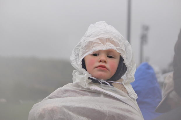 Boy in Rain with plastic cover